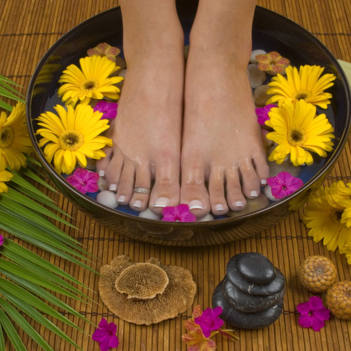 Spa treatment with aromatic gerbera daisies, healing stones, olive oil soaps and mineral water